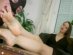 Slave Sucks And Licks The Feet Of The Beautiful Mistress